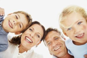 family-of-dental-clients-with-a-dentist-whos-goal-is-to-help-them-achieve-optimal-oral-health-and-keep-their-teeth-for-life
